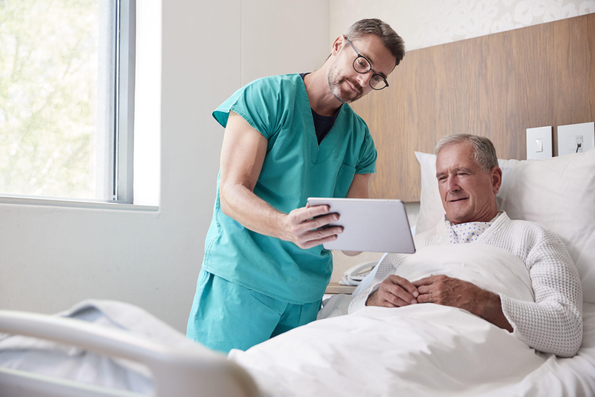 Man visiting with surgeon pre surgery